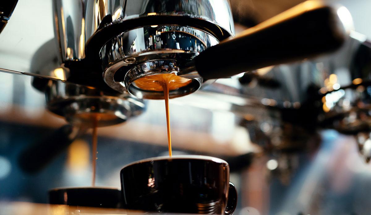 Espresso machines making coffee